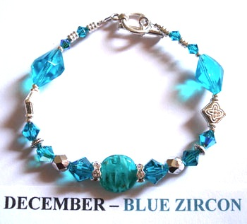 Fashion Bracelet with Blue Zircon coloured Venetian glass disc surrounded by Swarovski crystals depicting the birth month and colour of DECEMBER