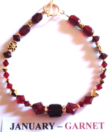 Bracelet with Garnet coloured Swarovski crystals depicting the birth month and colour of JANUARY