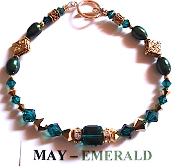 Bracelet with Emerald coloured Swarovski crystals depicting the birth month and colour of MAY