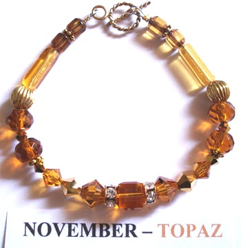 Fashion Bracelet with Topaz coloured Swarovski Crystals depicting the birth month and colour of NOVEMBER