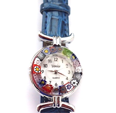 100% Murano Watch with beautiful classic millefiore decoration around a silver bezel with a 15mm diameter watch face. This watch is on a lovely blue leather band and has a quartz movement. Each watch has a guarantee and is presented in a nice box with a RITZYROCKS cleaning cloth. Please note that due to the handmade design there may be a slight variation in the flowers. PRICE -  55.00