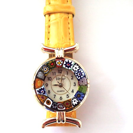 100% Murano Watch with beautiful classic millefiore decoration around a gold bezel with a 15mm diameter watch face. This watch is on a lovely yellow leather band and has a quartz movement. Please note that designs may vary ever so slightly. PRICE -  60.00 .