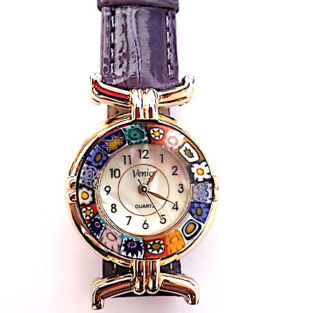 BACK IN STOCK - 100% Murano Watch with beautiful classic millefiore decoration around a gold bezel with a 15mm diameter watch face. This watch is on a lovely purple leather band and has a quartz movement. Each watch has a guarantee and is presented in a nice box with a RITZYROCKS cleaning cloth. Please note that due to the handmade design there may be a slight variation in the flowers. PRICE -  55.00